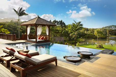 Wood-Deck-Flooring-and-Chaise-Lounges-with-Cushions-near-Square-Pool-and-Outdoor-Bed-inside-Wooden-Gazebo-in-Tropical-patio-Design-Ideas